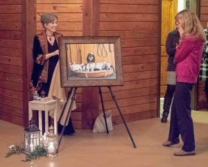 Mary Eaton Bliss presenting the surprise painting